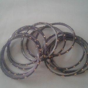 DELI HOUSE  black/gold sparkly bracelets.    NWOT